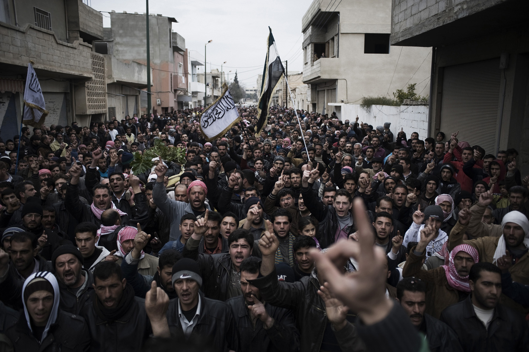 Alessio Romenzi. Al Qsair. Thousands attend the funeral of the the three men kidnapped and tortured by shabiha (militias of the regime) during three days. The bodies were found  in a main street of Al  Qsair, on February 14, 2012.  Courtesy Alessio Romenzi