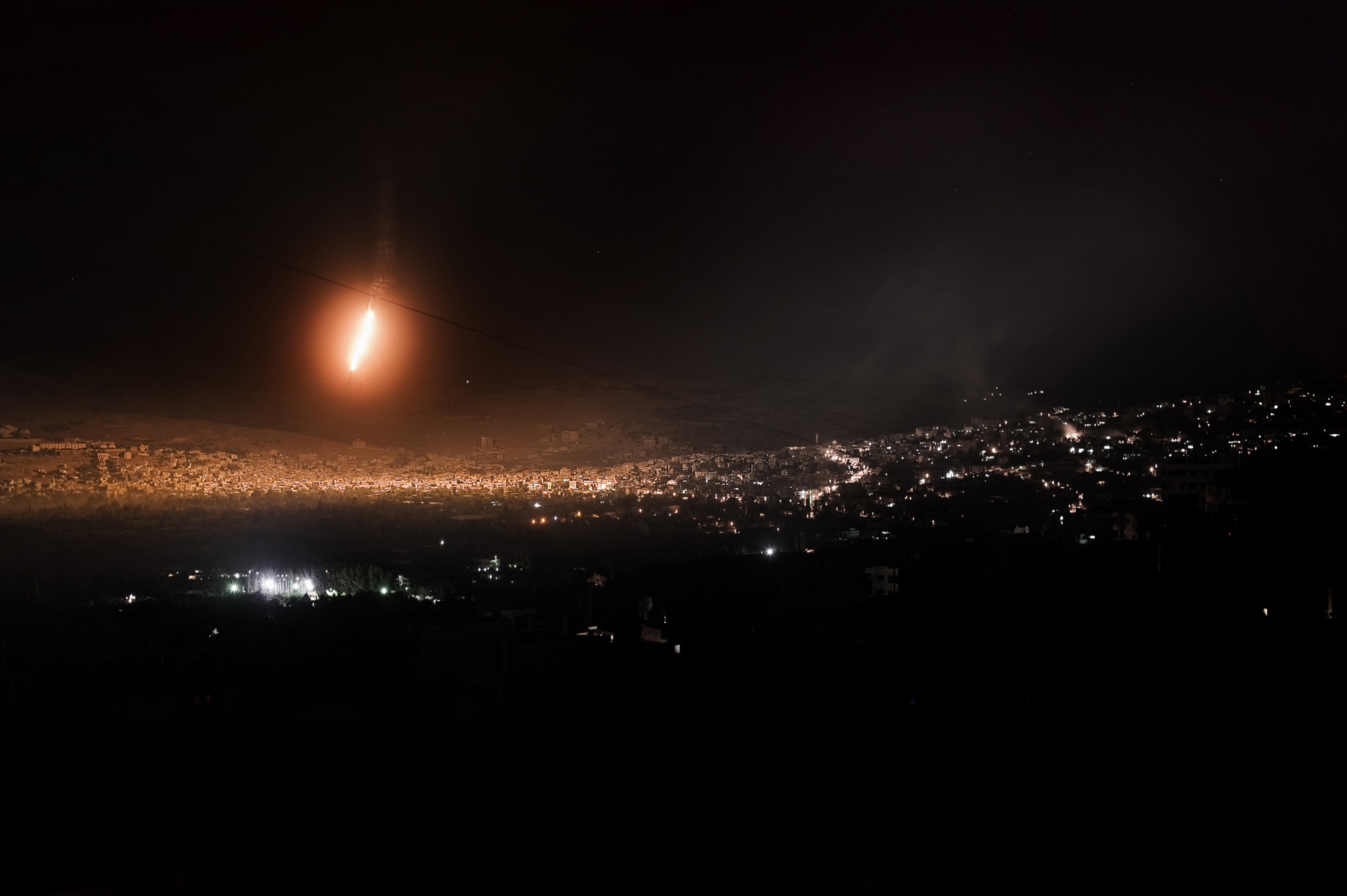 Alessio Romenzi. Syria, Zabadani. Heavy shelling on the restive village of Zabadani. At night Al Assad army shot